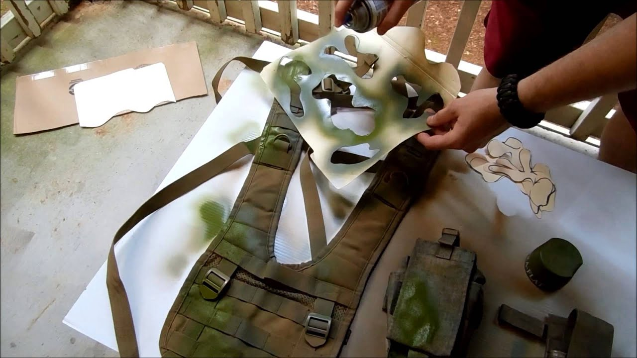 Person Dying a plate carrier with spray paint and stencil