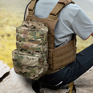 Person sitting while wearing a tactical bag on plate carrier on back side