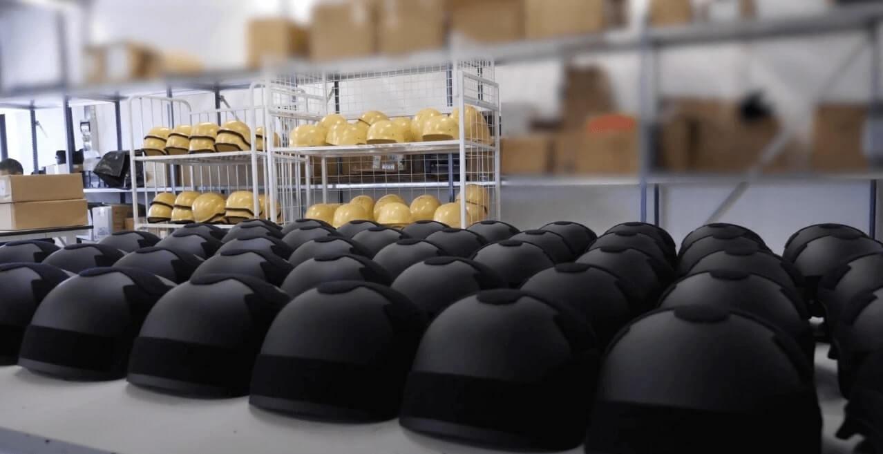 Black color ballistic helmets on table ready for final inspection
